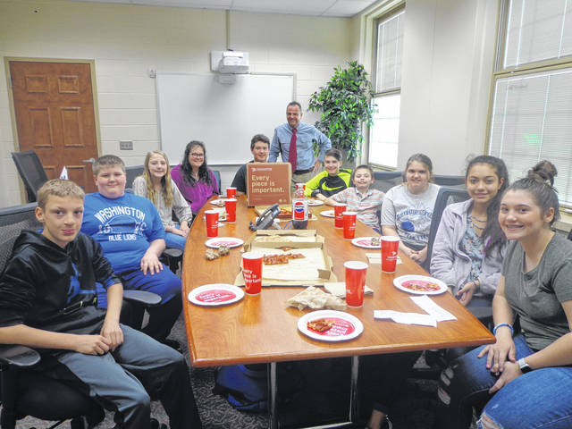 "Donatos recently provided pizza to these students at Washington Middle School as they celebrated ""Pizza with the Principals."" This is in appreciation for their selection as Students of the Month for April. They are chosen by their teachers because of the outstanding example they set for their peers in such areas as academic effort, good work ethic, kindness to others, and service to their school. Pictured (L to R): Christian Scott, Logan Miller, Natalie Truex, Stephany Matheny, Jayden Mitchell, (Mr. Montgomery, Asst. Principal) Jackson Powell, Domanik Mongold, Dakota Amburgey, Gabby Gonzalez and Savannah Osborne."