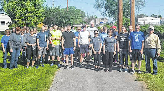 Melissa and Jim Garland invite the community to join them for the eighth-annual Great Strides 5K. Pictured are participants from last year's event.