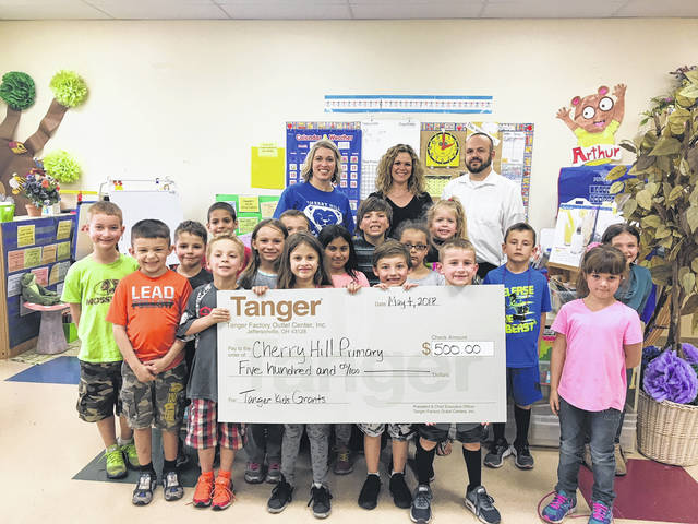 Tanger Outlets Jeffersonville recently presented at TangerKIDS grant to Cherry Hill Primary School.