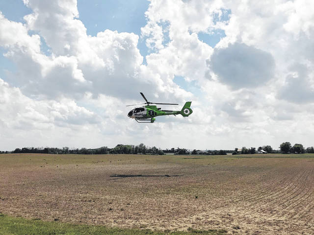 The passenger, Rebecca Throckmorton, was flown by medical helicopter to an area hospital. She was ejected from the vehicle during the accident.