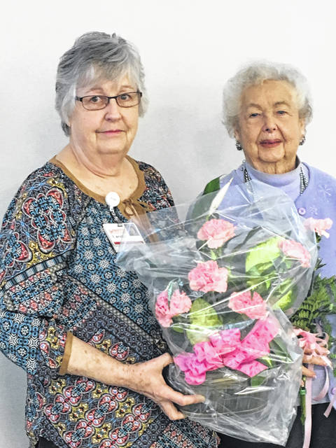 The Auxiliary at Fayette County Memorial Hospital is spending the year celebrating 40 years as a service group. At a recent meeting, Jodi Hanawalt was presented with a bouquet of flowers by president Carolyn Reinwald, recognizing the 40 years she has been a member and the 8,000 hours she has accumulated. Hanawalt is active in the sewing room preparing for the Holiday Bazaar held every November.