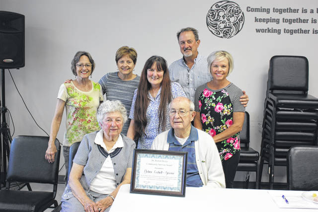 Debra Grover with Dr. and Mrs. Heiny and members of his family; Robyn Frazier, Jill Cipra, and Mark and Jenni Heiny. Debra received the Dr. Robert Heiny award.