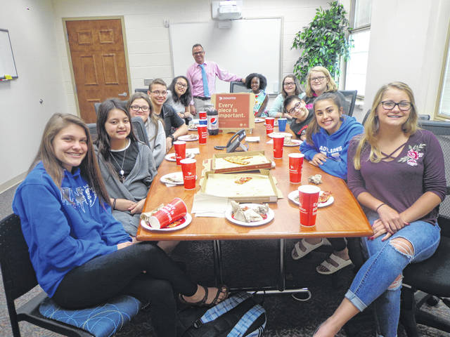 """Donatos recently provided pizza to these students at Washington Middle School as they celebrated """"Pizza with the Principals."""" This is in appreciation for their selection as Students of the Month for May. They are chosen by their teachers because of the outstanding example they set for their peers in such areas as academic effort, good work ethic, kindness to others, and service to their school. Pictured (L to R): Ellie Lynch, Mya Perez, Racine Grim, David Surina, Jenteal Larson, Mr. Montgomery, assistant principal, Kierstyn Mitchell, Mayleigh Koutz, Lorelei Taylor, Parker Foy, Aaralyne Estep and Kassidy Olsson. Absent from the photo were Scottie Forsha and Maggie Copas."""