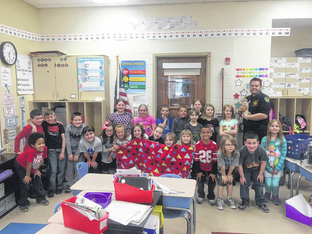 Students at Cherry Hill Primary recently donated to the Fayette Regional Humane Society as part of a service learning project. Shannon Drake's second grade class made no-sew blankets for the animal shelter.