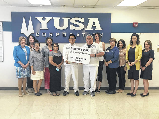 YUSA Corporation has been selected as the Fayette County Chamber of Commerce Business of the Month. Established in Washington C.H. in 1987, YUSA is an industry leader in the manufacturing of automotive rubber components, specializing in engine mountings, bushings, tubes and hoses. Pictured are president and CEO of YUSA, Yukimitsu Minamibata, and Paul Grubb of YUSA, as well as the Chamber ambassadors. The Chamber thanked YUSA for their commitment to the community and for their Chamber membership.