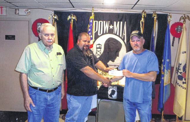 Joshua Brunck of Cohen Recycling donated to the VFW Post 3762. Pictured (L to R): Bob Malone, Joshua Brunck and Tracy Patterson.