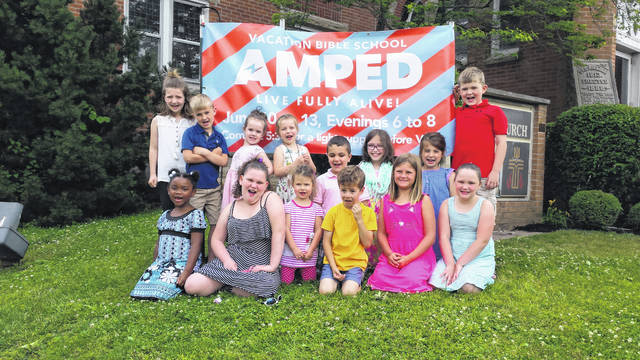 "Plan to share electrifying fun, laughter and a lot of God's Word at AMPED VBS June 10-13 in the evenings from 6-8 p.m. with a light supper at 5:30 p.m. at First Presbyterian Church, 214 N. Hinde St. in Washington C.H. The ""Kingdom Kids"" from left to right in back row: Molly Preston, Ethan Garrison, Hannah Rohr, Hannah Preston, Remington Butcher, Taylor Booth, Tillie Abbott and Tommy Garrison; front row: Simone Elkins, Rilyn Jones, Grace and AJ Armintrout, Cambry Brown and Kahlen Jones."