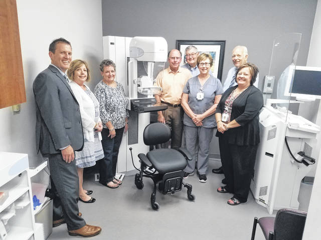 The Fayette County Memorial Hospital Foundation recently purchased two new pieces of equipment for various departments in the hospital. The Women's Wellness Center received a mammography chair. The unit was ordered from Europe and will be very beneficial to patients who are unable to stand for long periods of time. Pictured (L to R): Front row: Kathy Dean- Foundation board member, Whitney Gentry- Foundation Director, Niko Hagler- FCMH Laboratory Leader, Dr. Norma Kirby- Foundation board member, Alicia Moody – FCMH Phlebotomy Section Manager, and Vanessa Blevins - Foundation board member. Back row foundation board members Rob Herron, Ron Ratliff, Mike Diener, Andrew Daniels and Roger Kirkpatrick.