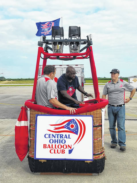 The fourth-annual Fayette County Toast to Summer & Hot Air Balloon Glow was held on Saturday with a large crowd joining for the day-long event. Isaac Butler jumped into a hot air balloon basket for a quick photo while the members of the Central Ohio Balloon Club show him the flight equipment.