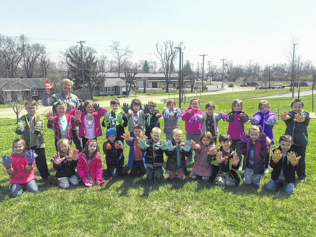 Stacey Jenkins' kindergarten class cleaned up the grounds of the elementary school by picking up leaves, trash and weeds. Students took pride in themselves and their school as they cared for the campus.