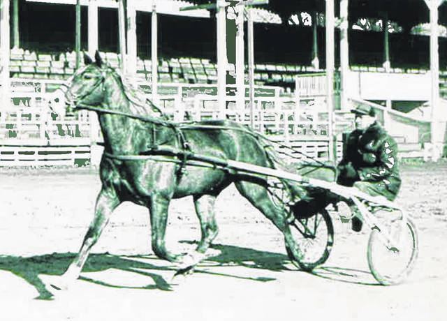 Harold Laymon jogging 2-year-old Jerry the First at the Fayette County Fairgrounds.