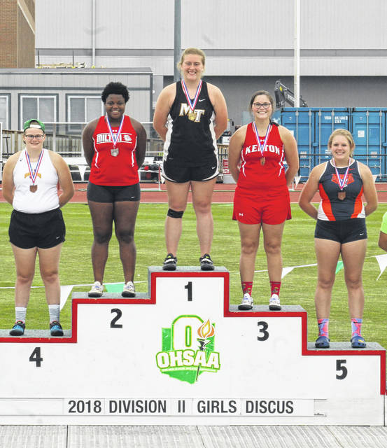 """Miami Trace's Katie Seyfang stands atop the podium at the Division II State track and field meet after capturing the discus throw title with a new school record throw of 144' 5"""" Friday, June 1, 2018. (l-r); Autumn Mohan of Unioto, Beyonce Bobbitt of Milton-Union, Seyfang, Lauren Johnson of Kenton and Briana Streib of Galion."""