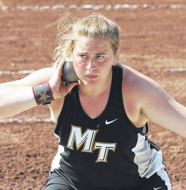 "Katie Seyfang prepares to throw in the Division II State shot put championship Saturday at The Ohio State University. Seyfang placed third with a throw of 42' 4 1/4""."