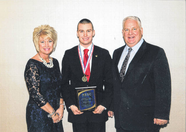 Spencer Minyo (middle) was honored recently at the 29th-annual Franklin B. Walter All-Scholastic Awards Program. With Minyo are Beth Justice, superintendent of the SOESC, and Chris Keylor, 2018 chairperson from the Ohio Education Service Center Association.