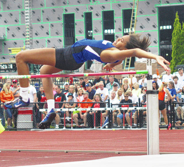 "Washington High School sophomore Rayana Burns clears the bar in the high jump Friday morning, June 1, 2018 at the 44th annual girls State track and field meet at The Ohio State University. Burns placed third in the event with a jump of 5' 4""."