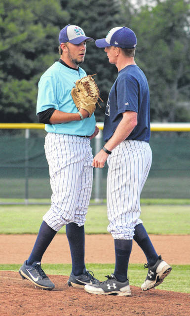 Manager Tucker Hughes, right, speaks with pitcher Nickolas Hertz, Mississippi Gulf Coast Community College.