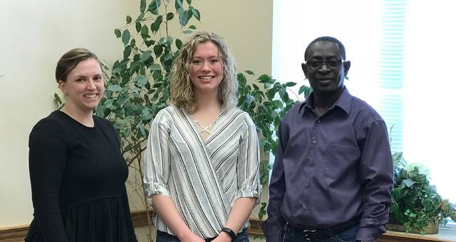 Erin Rickman, Clare Sollars (middle) and Godwin Apaliyah celebrate Clare Sollars' completion of the year-long mentorship program.