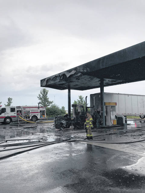 Firefighters quickly extinguished a fire that engulfed a semi-truck tractor cab Friday morning at the Interstate 71/U.S. Route 35 Shell True North station.