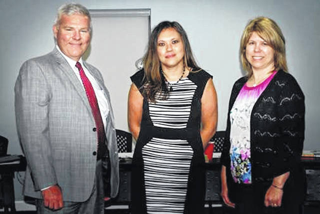 Michael P. Pell II, Tracy O'Hara, and Rachel D. Cummings (l-r) are sworn in as appointees to the Southern State Community College Board of Trustees.