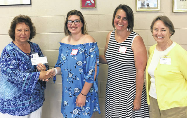 Abigail Sever, a 2018 Washington High School graduate, recently received the Fayette County Retired Teachers annual scholarship. She will attend Bowling Green University and will major in education and music. From left to right are Susan Stuckey, FCRT president; Abigail Sever; Susan Sever (Abigail's mother); and Bobbi Long, scholarship chair for FCRT.