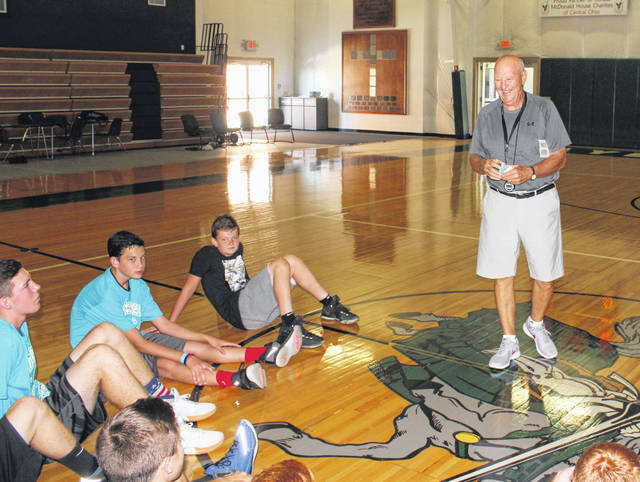 Gary Shaffer, the new Fayette Christian School basketball coach, at right, speaks with the participants of a basketball camp which wrapped up at the school Thursday, July 26, 2018.