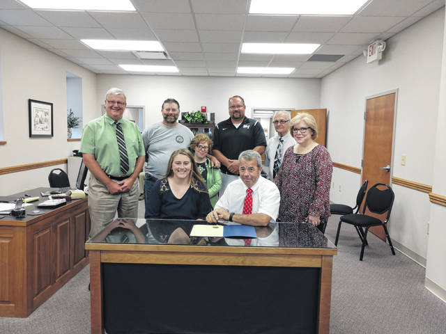 Katie Seyfang was honored Monday by the Fayette County Commissioners at their office with a proclamation acknowledging her history making first place in the discus competition at the 44th-annual girls state track and field meet in June. Pictured (L to R): front row: Katie Seyfang and commissioner Tony Anderson. Back row: commissioner Dan Dean, Mike Seyfang, Raye Seyfang, Brent Noes, commissioner Jack DeWeese, and Ricky Seyfang.