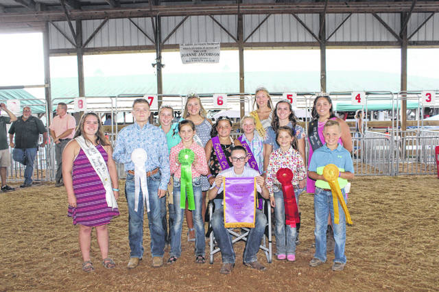 Zander Ivey (seated) won the overall swine showman Tuesday at the Fayette County Junior Fair Swine Showmanship competition. In the front row (left to right) surrounded by fair royalty are the other showmanship winners: Kylan Knapp (third place), Emily Reeves (fifth place), Alison Reeves (reserve champion showman), and Kaden Bryant (fourth place).