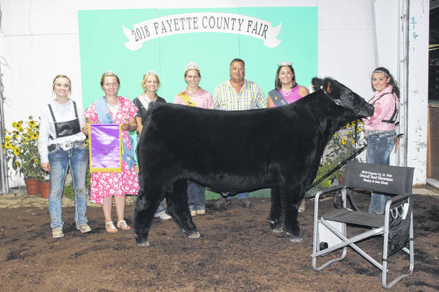 McKenzie Riley was named the overall beef showman on Tuesday evening at the 139th-annual Fayette County Junior Fair Beef Show following two shows that lasted around seven hours. Pictured with Riley (L to R): Macie Riley, Fayette County Fair Queen Attendent Victoria Schappacher, Fayette County Dairy Princess Anita Pursell, Fayette County Beef Queen Victoria Schappacher, judge Oran Wolfe and Fayette County Fair Queen Jordan Bernard.