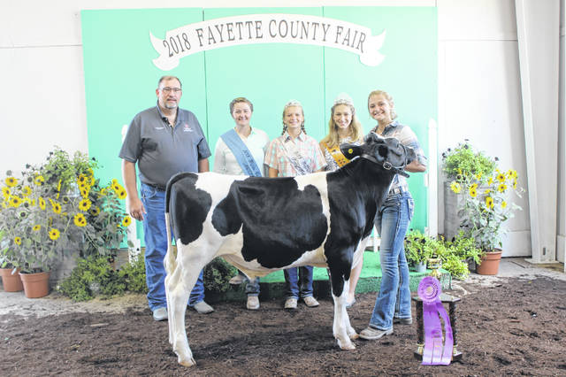 Taking reserve grand champion was Alexia Cusic. Pictured with Cusic (L to R): Judge Jeff Fisher, Fayette County Fair Queen Attendant Victoria Schappacher, Fayette County Dairy Princess Anita Pursell and Fayette County Beef Queen Victoria Waits.