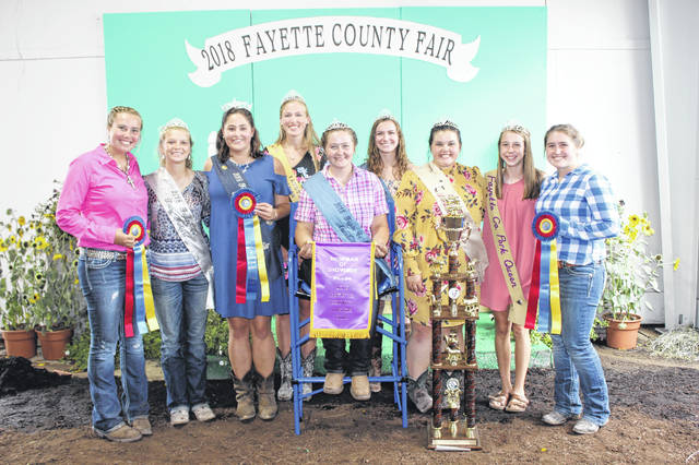 Fayette County Fair Queen Attendant Victoria Schappacher (seated) was named the Showman of Showmen following the competition on Saturday afternoon which included 13 competitors from the various animal projects on the fairgrounds. Pictured with Schappacher (L to R): Fayette County Dog Ambassador Khenadi Grubb, Fayette County Dairy Princess Anita Pursell, Fayette County Fair Queen Jordan Bernard, Fayette County Horse Queen Andrea Robinson, Fayette County Fair Queen First Attendant Haley Copas, Fayette County Lamb & Wool Queen Abigail Mick, Fayette County Pork Queen Aubrey McCoy, and Fayette County Small Animal Queen Aubrey Schwartz.