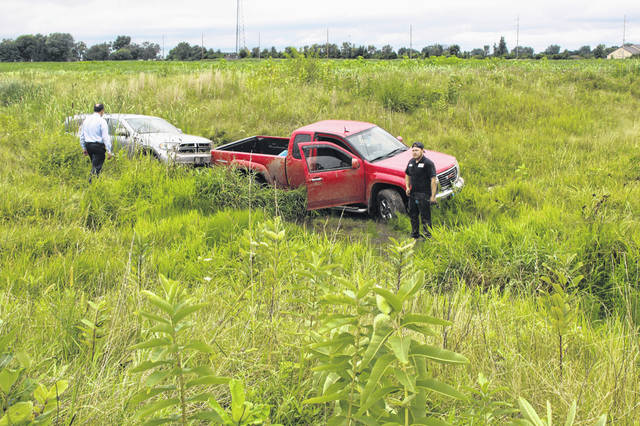 Several vehicles were removed from a bean field on Rowe Ging Road Tuesday following a reported chase which involved the Washington Court House Police Department, the Fayette County Sheriff's Office and an allegedly stolen red 2011 GMC Canyon truck. Two people, Tyler Stone, 29 of Mt. Sterling, and Katherine Ross, 25 of Jeffersonville, were reportedly caught following the chase, which traveled through several fields and yards in the area.