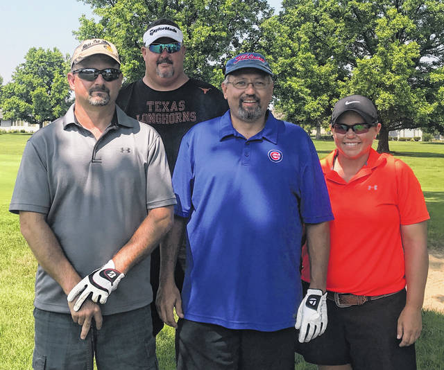 The winning team, scoring a 61, consisted of (l-r); Jeff Creamer, Jake Dawson, Amanda Dixon and, in back, Steven Armstrong of ERA Associates.