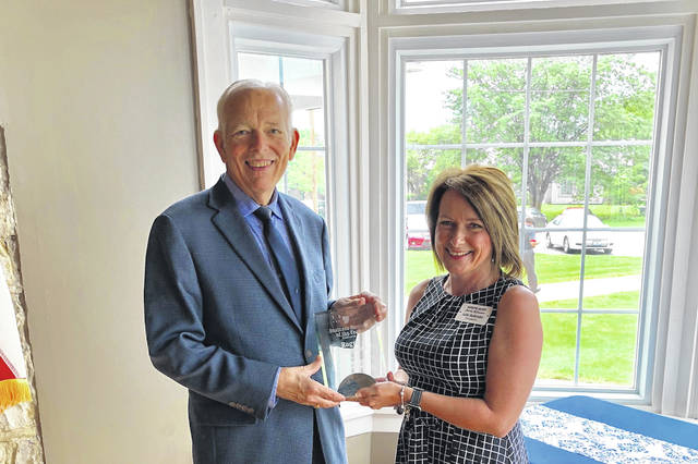 Roger Kirkpatrick received the prominent Business Person of the Year Award at the Chamber Luncheon. Chamber President Julie Bolender presented the award.