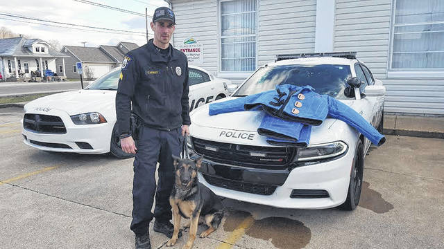 """Christopher Mosley poses with his K-9, """"Lana,"""" while a sergeant for the Piketon Police Department."""