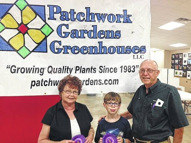 Ron Burke pictured with Sue Garringer who won Best of Show Paintings and Drawings in the senior citizen division and Titus Lehr won Best of Show in the junior division in 2015.