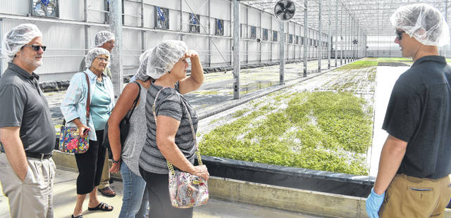 Apprentice Grower Johnny O'Neal, right, takes a group of locals on a tour of BrightFarms on Friday. For more photos of the event, visit wnewsj.com.
