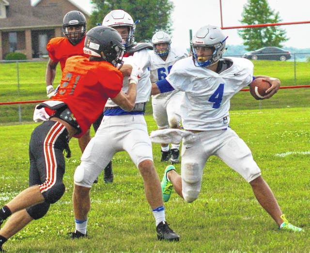 Washington's Dillon Steward (4) carries the ball during a scrimmage at Amanda Clearcreek High School Friday, Aug. 17, 2018. It was the final preseason scrimmage before the Blue Lions open the regular season next Friday at Blanchester against the Wildcats. Also pictured for Washington are Eli Shaw (blocking) and Alec Haggard.