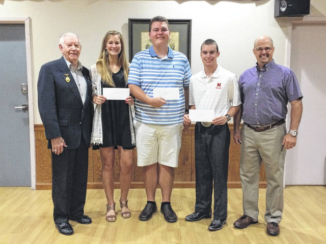 Pictured are Elks Past Exalted Ruler and scholarship committee member Ed Helt, scholarship winners Victoria Fliehman, Dylan Page, Spencer Minyo, and scholarship chairman Matt Barga.