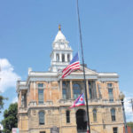 Flags fly at half mast in honor of Ron Burke