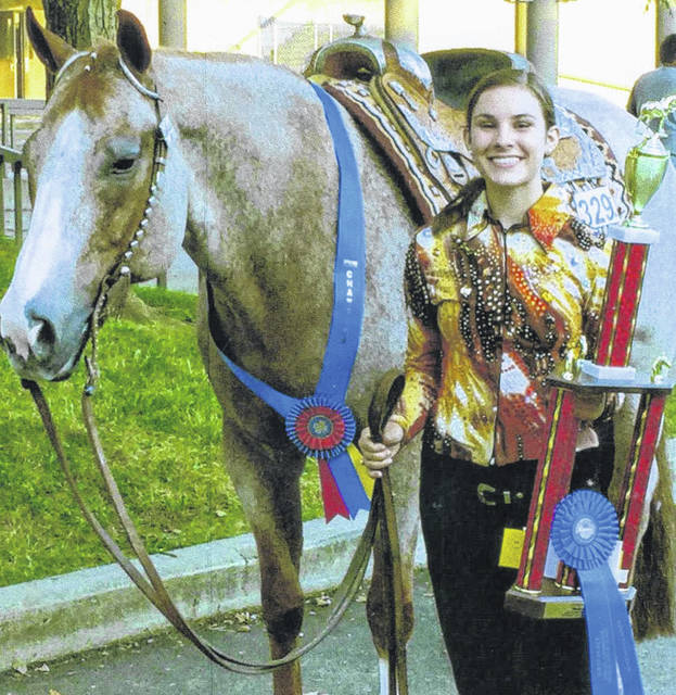 Madison Johnson, of Bloomingburg, represented Fayette County at the Ohio State Fair with her horse. She won her age group of Western Pleasure, and then won the Western Pleasure Championship Class of all ages.
