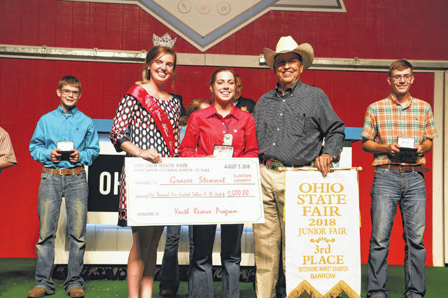 Miami Trace High School FFA member Gracee Beth Stewart of Clinton County, and member of Blue Ribbons Kids 4-H club, was awarded at The Ohio State Fair: third Overall Swine Outstanding Market Exhibitor, 14-year old overall Outstanding Market Exhibitor, 14-year-old second in Skillathon, ninth overall Outstanding Breeding Gilt Exhibitor Ohio State Fair. Stewart attended the Sale of Champions at the Ohio State Fair to be awarded her overall check and Belt Buckle for her third overall exhibitor and overall age group earnings. Stewart is the daughter of Billy and Jenny Stewart, and is a sophomore.