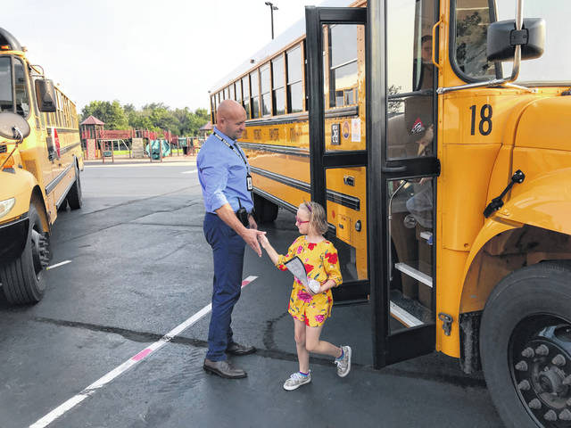 Justin Lanman, an assistant principal at Miami Trace Elementary School, greeted students as they got off the buses Wednesday morning.