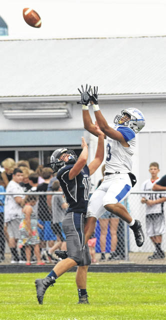 Omar Porter goes up for a pass reception for the Blue Lions in their season-opening game at Blanchester High School Friday, Aug. 24, 2018.