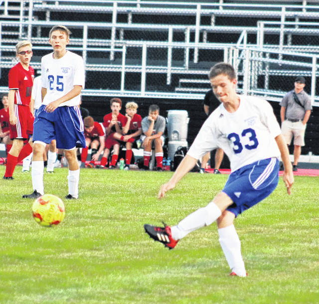 Washington's Preston Hines (33) passes the ball during a non-conference match at Circleville Thursday, Aug. 23, 2018. Also pictured for the Blue Lions is Bryce Coy (25).