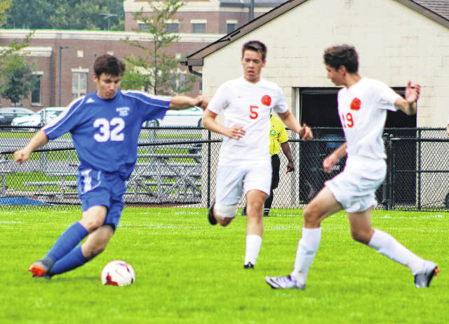 Ryan Schwartz possesses the ball for the Blue Lions during a non-conference match against Wilmington at Washington High School Saturday, Aug. 25, 2018.