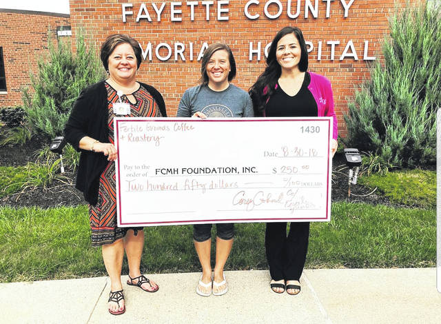"""Fertile Grounds Coffee and Roastery donated a portion of summer coffee sales to the emergency department remodeling fund of the Fayette County Memorial Hospital Foundation. Pictured from left, Whitney Gentry, FCMH Foundation Director, Cori Cockerill, owner of Fertile Grounds and Stephanie Campbell-Dunham, Foundation Coordinator. This is the second year Cockerill has travelled to the FMCH campus for summer coffee sales. """"We really appreciate Cori and her support of the FCMH Foundation and the community,"""" said Gentry."""