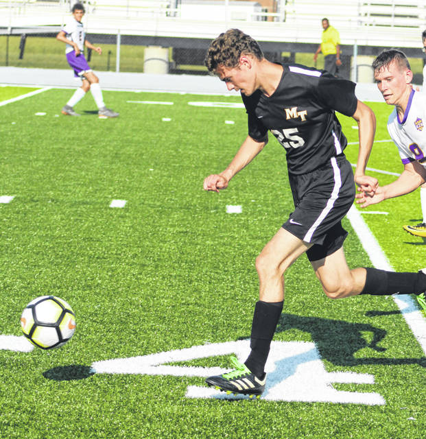 Miami Trace's Simon DeBruin charges ahead with the ball for Miami Trace during a Frontier Athletic Conference match against the McClain Tigers Thursday, Aug. 30, 2018 at Miami Trace High School.