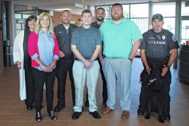 """Attending the presentation of the City of Washington Court House Police Department Scholarship are (l-r) Jessica Wise, Ph.D., SSCC Dean of Instructional Operations and Director of Fayette Campus; Nicole Roades, Ph.D., SSCC Vice President of Academic Affairs, Patrolman Mike Warnecke, scholarship recipient Trevor Phillips; Patrolman Alex George; Detective Jonathan Sever; and K-9 Handler Charles Hughes with """"Edo."""""""