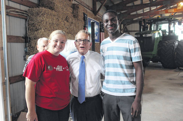 Ohio Attorney General Mike DeWine poses with Washington Court House High School seniors Christina Luebbe and Blaise Tayese.