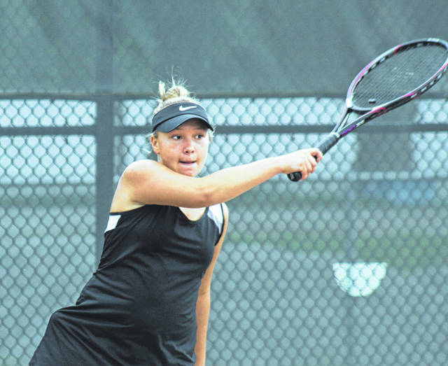 Cameron Bucher follows through on her forehand shot for Miami Trace during a Frontier Athletic Conference match against Hillsboro on the courts at Miami Trace Tuesday, Sept. 11, 2018.